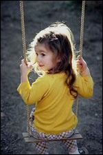 Young Girl on a Wooden Swing