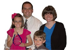 Wade Kapszukiewicz with wife, Sarah, and children, Emma and Will.